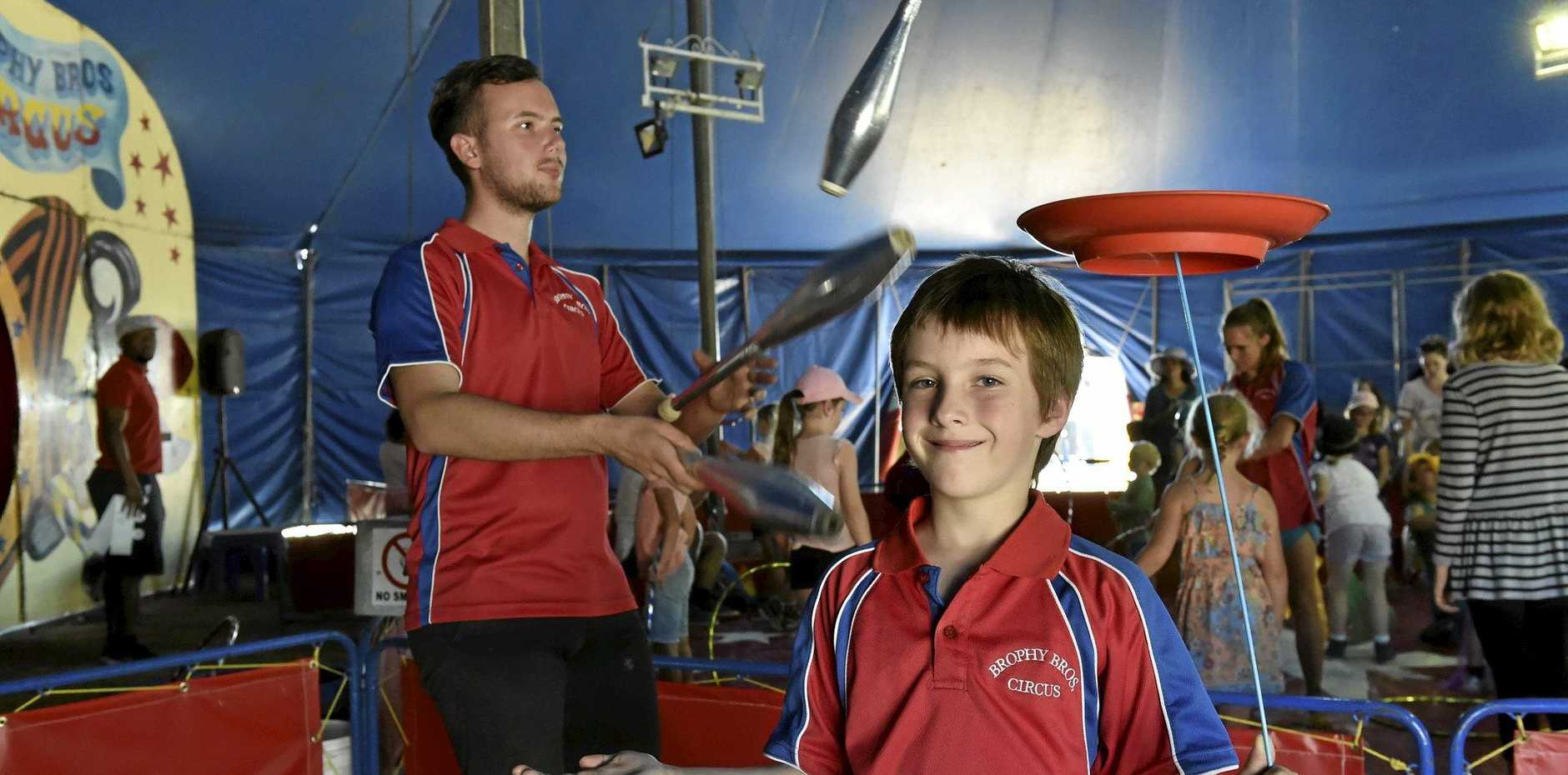 CIRCUS ACTS: Andrew (left) and Matthew Brophy show off their juggling and balancing skills.