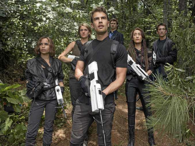 STARS: From left, Zoe Kravitz, Shailene Woodley, Theo James, Ansel Elgort, Maggie Q and Miles Teller in Allegiant.
