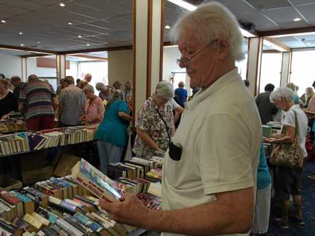 Maclean Rotary Book Sale veteran Russell Brownlee examines another possible inclusion in his large haul.