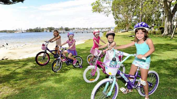 L-R: Jessica Stenner, Sienna Hilton, Charlotte Hilton, Jasmine Coulton and Kate Stenner took their bikes for a spin while on holidays in Yamba. The girls and their families have been camping at The Blue Dolphin for just over a week, and their parents described Yamba as