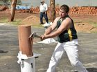 Crowd cheers on wood chopping champion