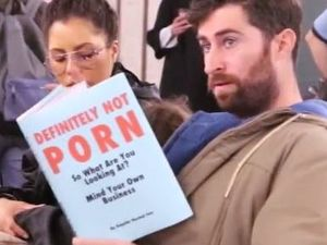 PHOTOS: Comedian reads worst books imaginable on a train