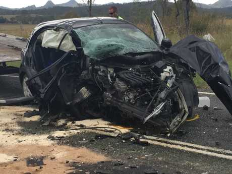 A man is dead and four women are in hospital following a three-vehicle traffic crash at Washpool on Friday morning.