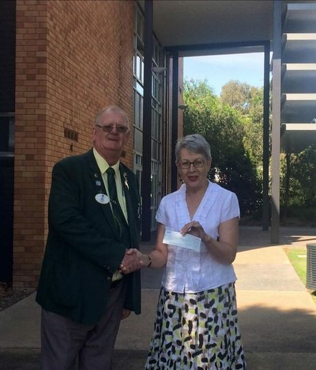 Lions District Governor Peter Oliver hands over the cheque for the refurbishment of the Lismore Lions Fountain to Lismore mayor Jenny Dowell.