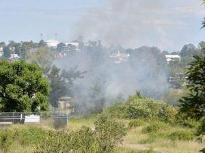 Grass fire behind Workshops Rail Museum