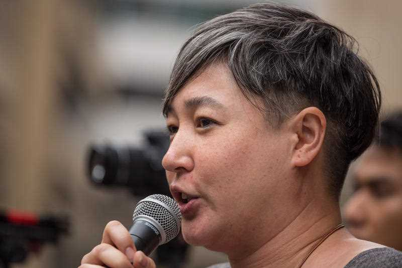 NSW Greens spokesperson Jenny Leong speaks to #StandUp4Refugees protesters during a rally at Sydney Town Hall on October 11, 2015. Thousands demonstrate across Australia to support asylum seekers and oppose mandatory detention.