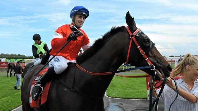 Jockey Matthew Paget returns to scale aboard Koodlydoe after winning at Coffs Harbour.