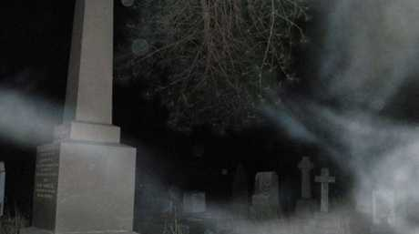 A spooky graveyard photo taken by the group.