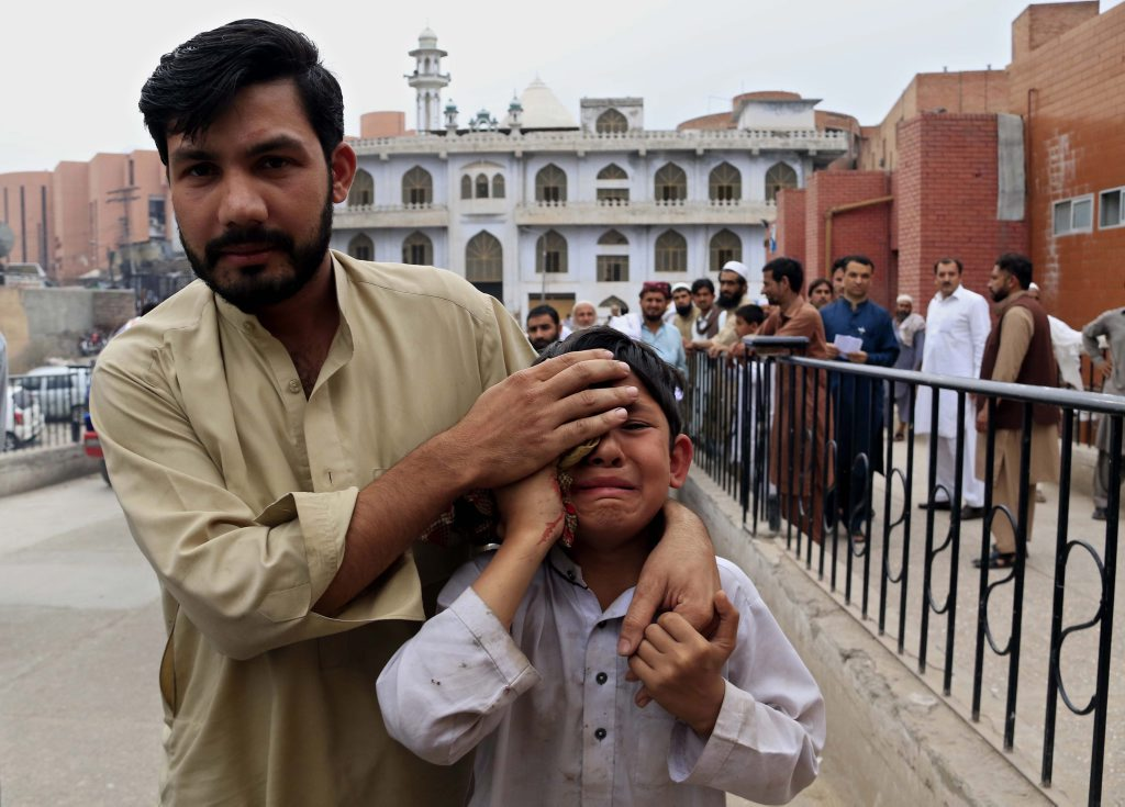 epa05252607 A boy who was injured in an earthquake cries outside a hospital in Peshawar, Pakistan, 10 April 2016. At least two people were killed and 25 injured in Peshawar following a 6.6 magnitude earthquake that was felt in Pakistan, Afghanistan and India. EPA/ARSHAD ARBAB