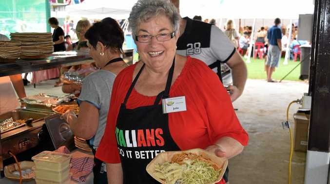 Volunteer Julie Denardi was kept busy serving three types of spaghetti sauce.