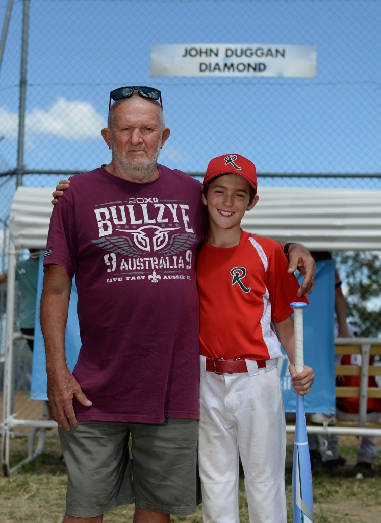 John Duggan with his grandson Dominic McMahon at the Kele Park softball centre where one of the diamonds is named in John's honour. Photo: Chris Ison / The Morning Bulletin