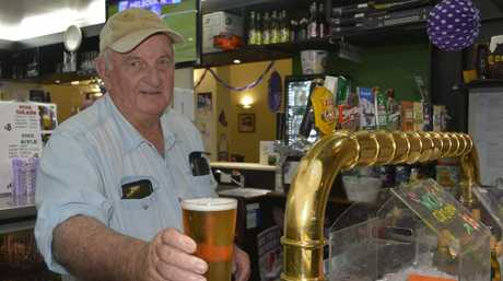 LAST DRINKS: The Gladstone Hotel owner Dennis Kelly is pouring his last drinks ahead of the building going to auction.