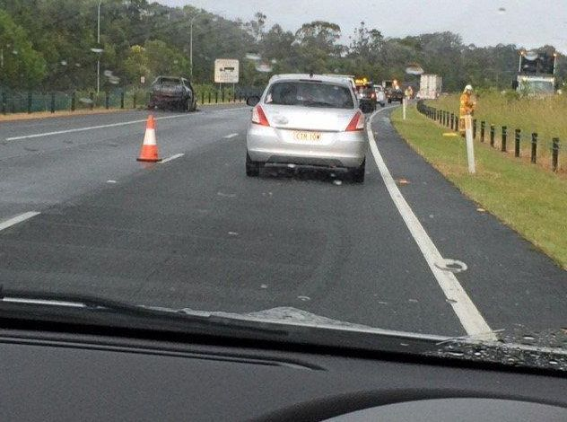 Traffic delays caused by a burning car on the Pacific Highway near Billinudgel.