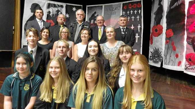 At Kyogle High School in front of Anzac banners are: back row: Dylan Rushby, Douglas Grove, Mark Hills (Kyogle RSL president), Jack McDonough, David Hanley. Third row: Jessica McPherson (art teacher), Mia McDonough (teacher), Gae Masters (principal, Danielle Mulholland (mayor), Second row: Students Daniel Williams, Matthew Cornell, Kirra Harrison, Rosie Dodge.Front row: studnets: Zoe Paull, Emily Davis, Ellora McKenzie and Ellie Moss.