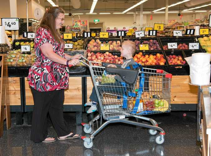 Lisa with her son Cooper using the additional needs trolley at Coles.