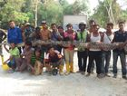 Members of Malaysia's civil defence force hold the python Herme Herisyam/Malaysia's Civil Defence Force