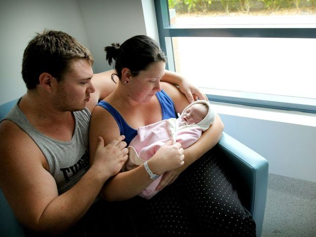 Aaron Taylor and Sarah Riseham with their daughter Scarlett Rose Taylor.