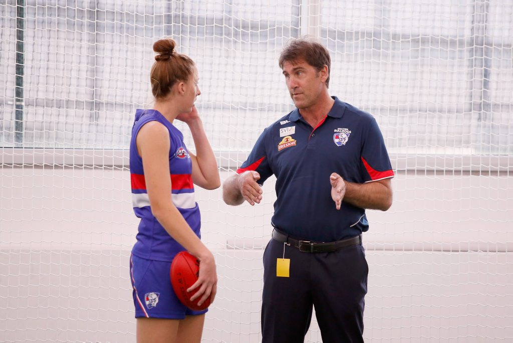 Coach Craig Starcevich in the rooms with player Emma King before the women's AFL exhibition match between the Melbourne Demons and the Western Bulldogs at Melbourne Cricket Ground last May. Photo:  Darrian Traynor/Getty Images.
