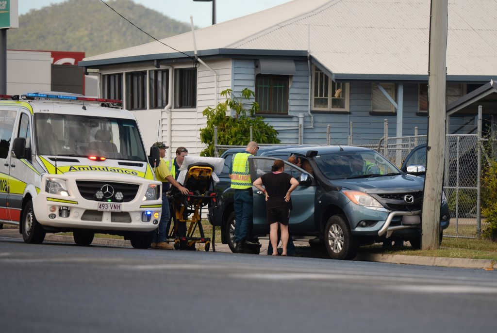 Emergency services at the scene of a car in to power pole one Archer Street. Photo Allan Reinikka / The Morning Bulletin