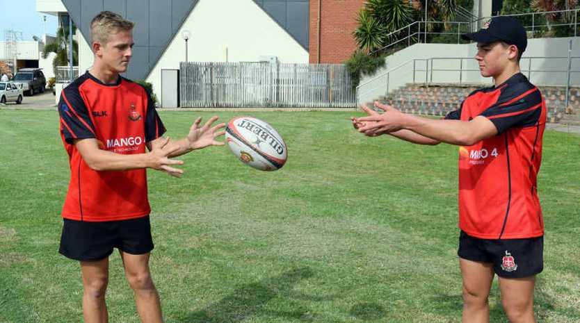 EYES ON THE PRIZE: Rockhampton Grammar rugby union teammates Leighton Milburn and Austen Routley show off their skills.