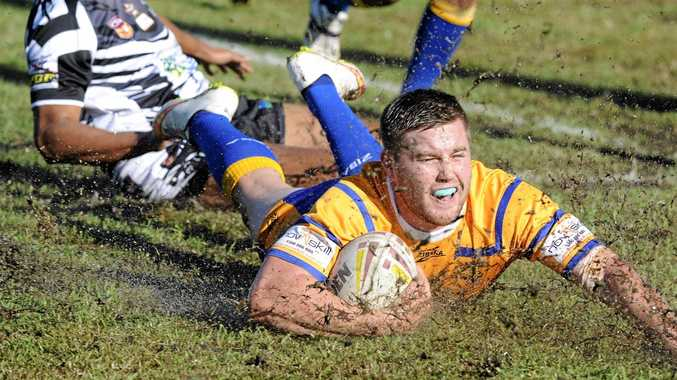 NOT THIS YEAR: Mullumbimby's Tim Browning scores a try in Northern Rivers Regional Rugby League last season. The Giants will not field a side in the NRRRL this season.
