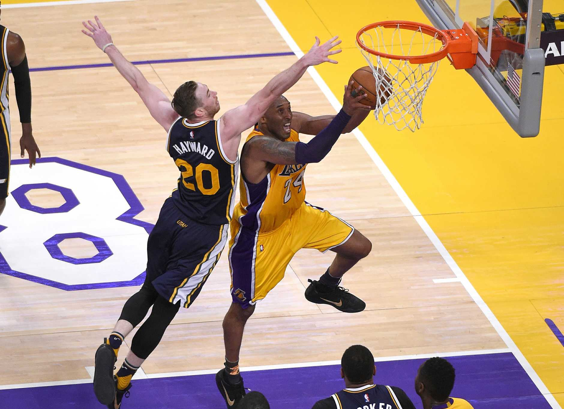 Bryant shoots as Utah Jazz forward Gordon Hayward defends during the second half. Photo: AP Photo/Mark J. Terrill.