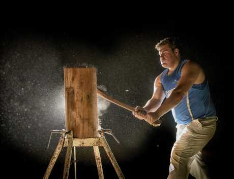 Chris Owen is geting ready for the woodchopping at the Grafton Show - pictured here chopping at night at the Maclean Show.