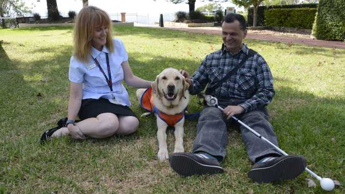 HELPFUL TOOLS: Toowoomba's Guide Dogs Queensland mobility instructor Mary Chapell, with Guide Dogs Queensland ambassador dog Barry and Toowoomba's Metin Bag who uses an ultra cane.