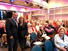 BACK AGAIN: Mayor Tom Tate with Deputy Mayor Donna Gates at a seniors concert on the Gold Coast.