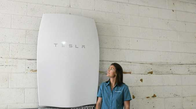 IMPRESSIVE: Clarence Community Transportt's Rhea Forshaw admires the new Tesla Powerwall recently installed, which is only the second in Australia.