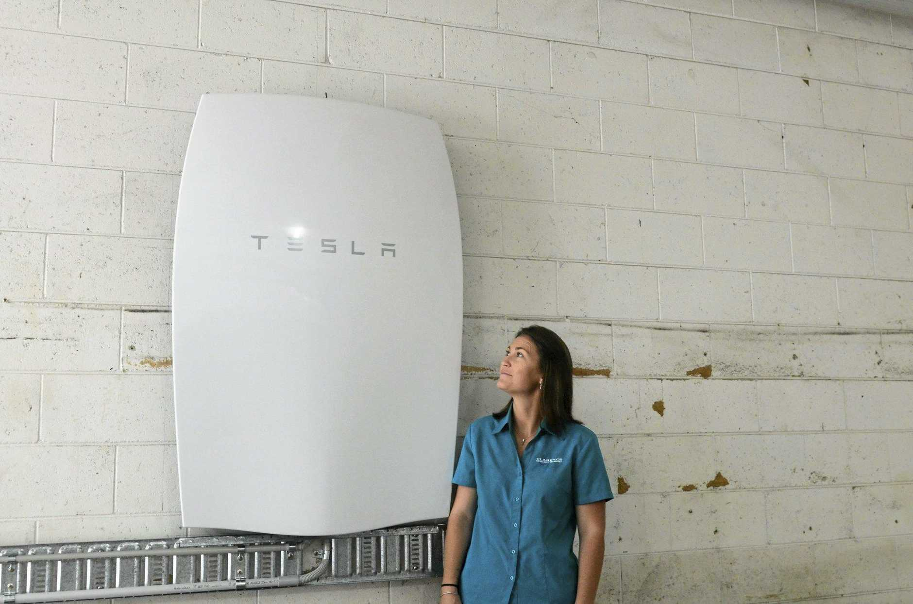 IMPRESSIVE: Rhea Forshaw admires the new Tesla Powerwall recently installed at Clarence Community Transport, which is only the second in Australia.
