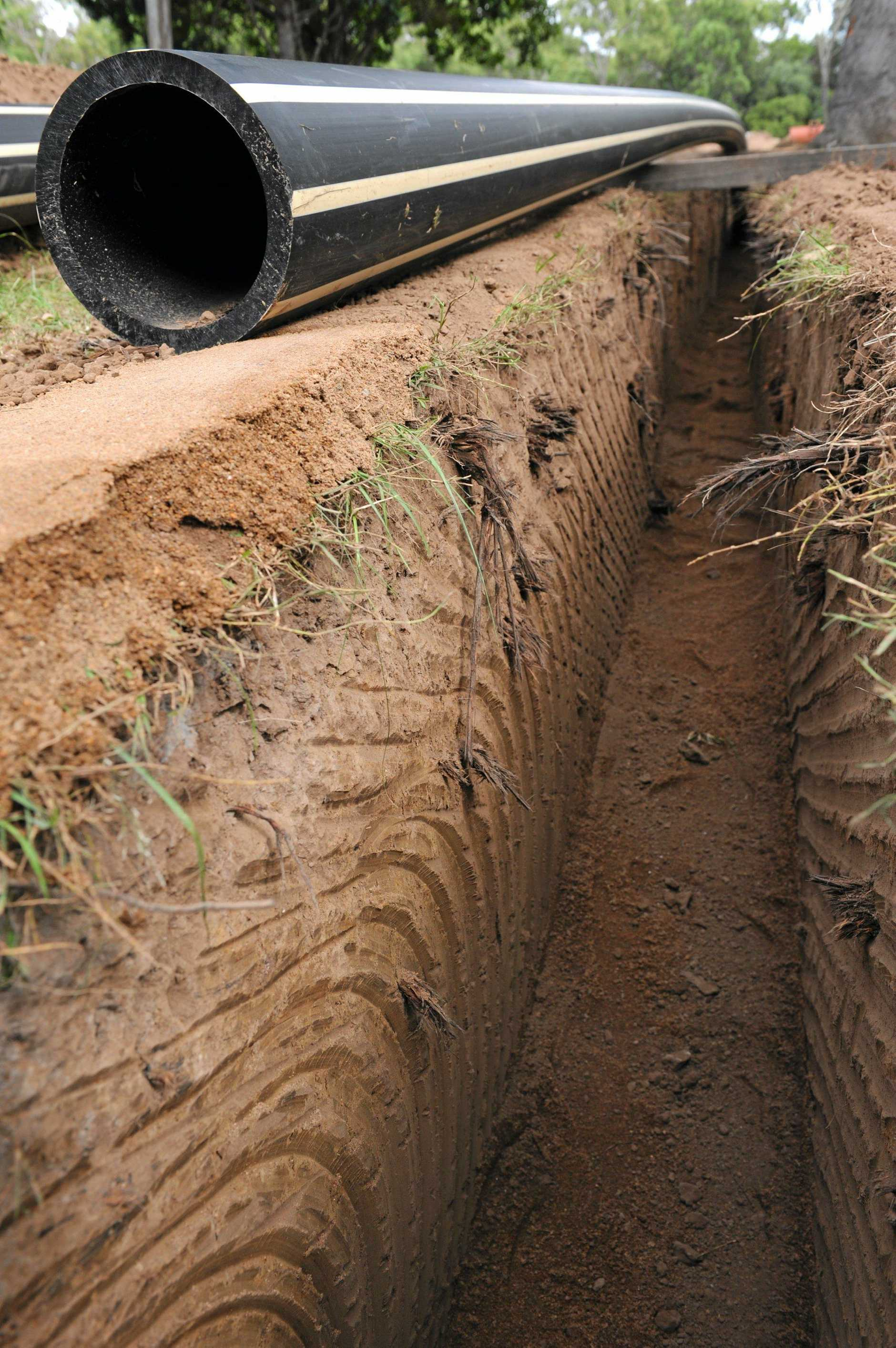 A section of poly sewerage pipe being laid between pump stations.