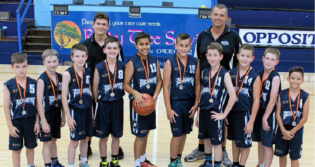STERLING EFFORT: The Rockhampton under-12 boys' basketball team (from left) Jack Tweedy, Charlie McDonald, Ben Tweedy, Mitchell Kuhl, Lleyton Muggeridge, Caiden Labone, Nicholas Houston, Zeb Whatmore, Jack Grayson and Lawson Britos, with assistant coach Malochi McPhail and head coach Paul Christensen.