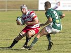 Matthew Krelle of Toowoomba Rangers looks to beat Condamine defender Sam McCosker during their round two Risdon Cup clash at Gold Park last Saturday.