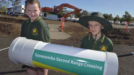 Murphys Creek State School Year 5 students Gabrielle Aiken and Lutin Cliff with a time capsule to be buried as part of the start of works on the Toowoomba Second Range Crossing.