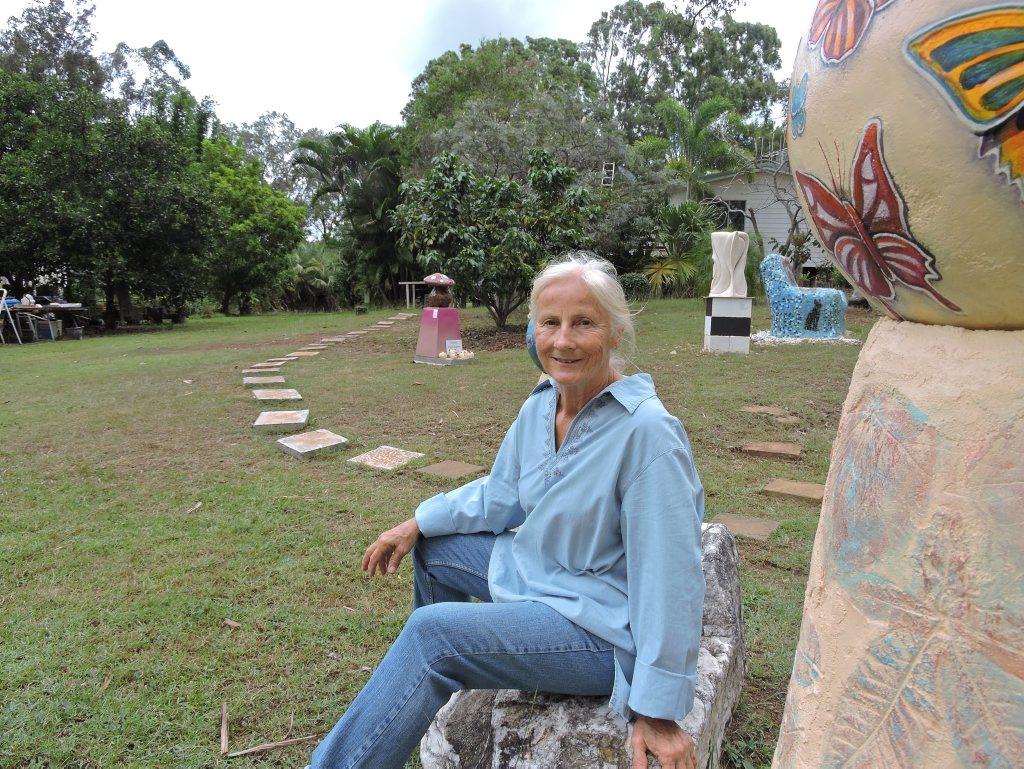 FAIRY GARDEN: Artist Monica Bayer sits among her sculptures at Alpha 31 in Tinana.
