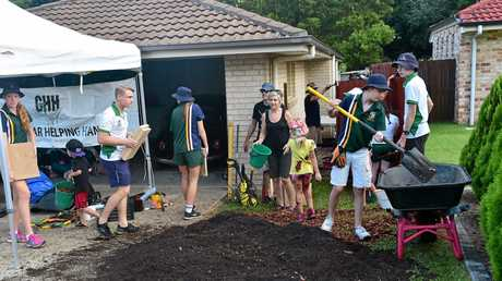Sunshine Coast Grammar students, staff and parents put on a backyard blitz for the Guymer family of Nambour as part of their Helping Hands Program. Elki Guymer, 3, was diagnosed with leukaemia this year. Photo: Che Chapman / Sunshine Coast Daily