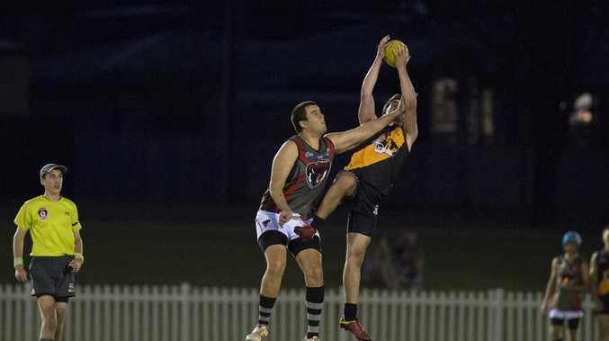 AERIAL CONTEST: Toowoomba Tiger Jonah Stower takes a grab despite attention from Lockyer Valley rival Paul Clark at Rockville Park.