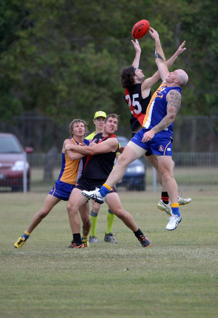 AFL ACTION: Hervey Bay Bombers' Luke O'Toole and ATW's Klint Wagstaff at Frank Coulthard Oval. Photo: Mike Knott / NewsMail