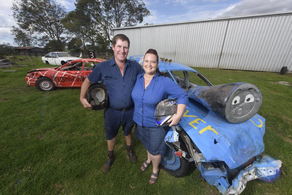 Daniel and Anita Moran of Townsend with the shells of their broken cars after Anita beat Daniel in the demolition derby at Maclean Show.