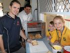 TOASTED: Vanderfield donated a commercial grade conveyor toaster to the Gatton State School chaplaincy program last week. Pictured is Gatton State School chaplain Tim Ormiston with Vanderfield sales representative Clayton Chisholm and Gatton State School students Charlotte Pieper and Tayissa Nawratzki with the new toaster.Photo Tom Threadingham / Gatton Star