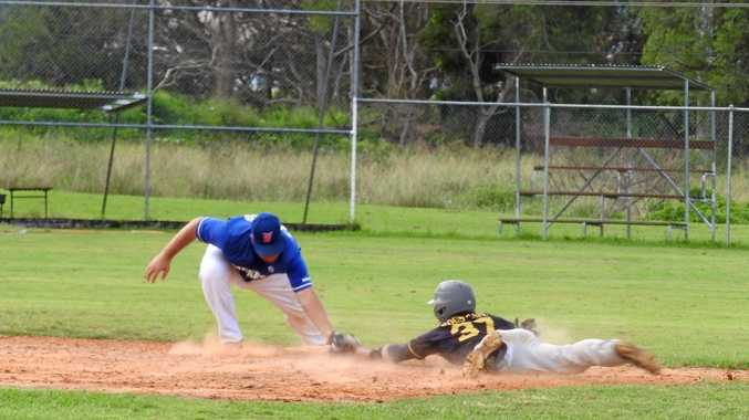 CLOSE CALL: Kodey WiIford (Brothers) is tagged out at second base by Micka McClelland (Workers) in a close play.