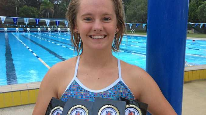 SUCCESS: Woolgoolga swimmer Taylar Briley with the medals she picked up at the NSW State Combined High Schools Swimming Championships.