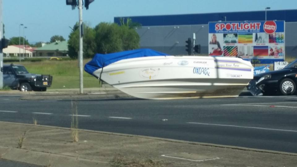 A boat is on the road on the Bruce Highway near Stockland Rockhampton following a single vehicle crash