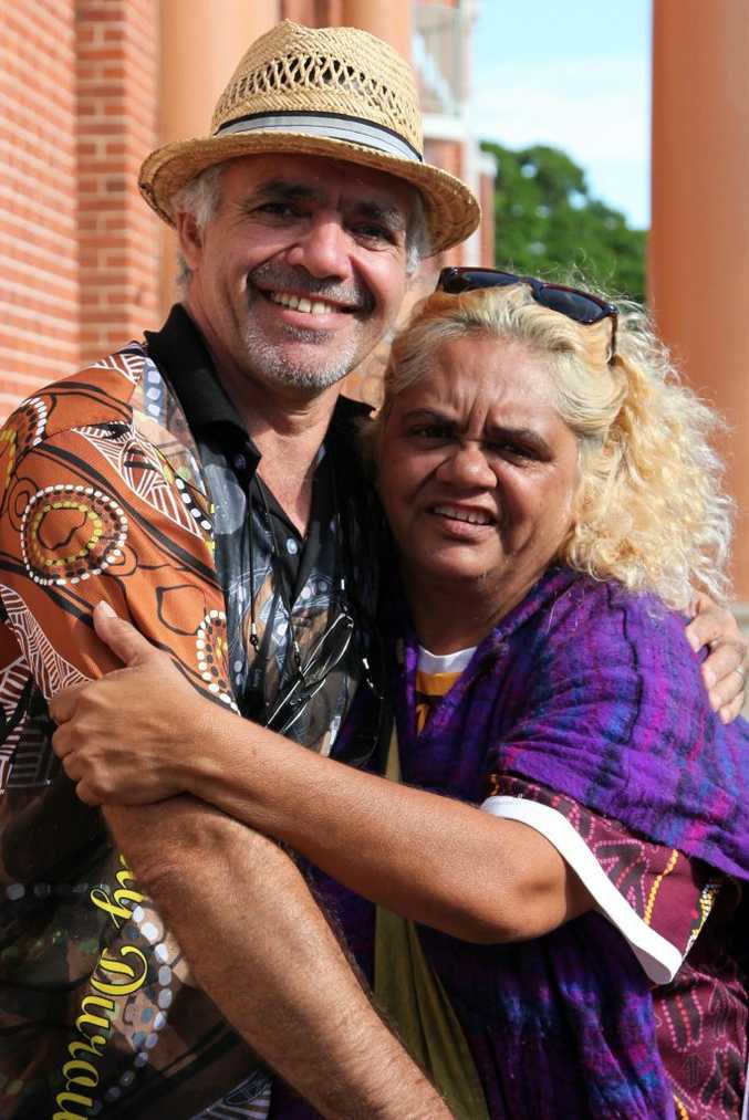 David Binge/Kirk of Brisbane catches up with Cynthia Button of Cherbourg at the Adani mining meeting in Maryborough on Saturday.