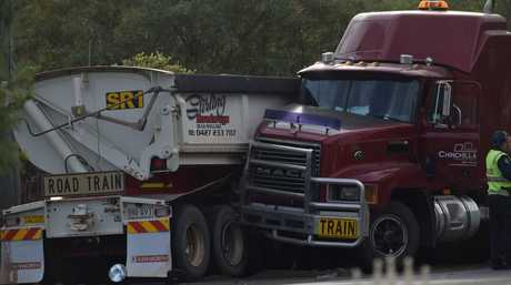 A man aged in his 50s was killed when the truck he was driving collided with a truck parked on the side of the Warrego Hwy.