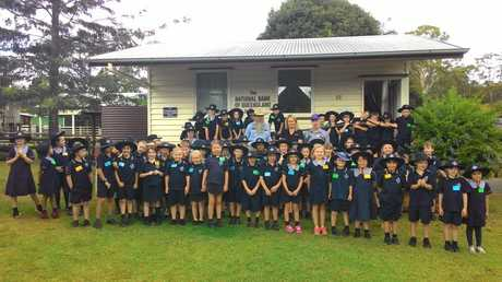 Middle Ridge State School students with Heritage Pioneer Village president Merv Polzin, Toowoomba Hospital Foundation CEO Alison Kennedy and Highfields Pioneer Village volunteer manager Ray Ashford.