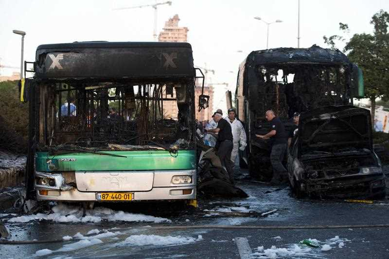 Israeli security officials investigate the scene following an explosion in Jerusalem, Israel, 18 April 2016. Israeli police report that the explosion was a result of an improvised explosive device (IED), likely at the back of the bus. Two other vehicles were damaged in the explosion. Medics reported 18 people were wounded in the explosion
