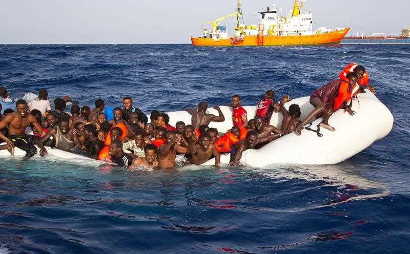 A handout photgraph made available by the Ong Sos Méditerranée showing migrants on a snking inflatable boat before being rescued by the Aquarius ship of the humanitarian group SOS Mediterranee, and taken to Lampesusa, Italy, 18 April 2016.