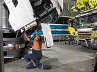 HARD AT WORK: The maintenence crew at a Scania servicing facility.